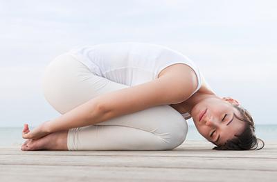 Yoga-Übung Kindhaltung